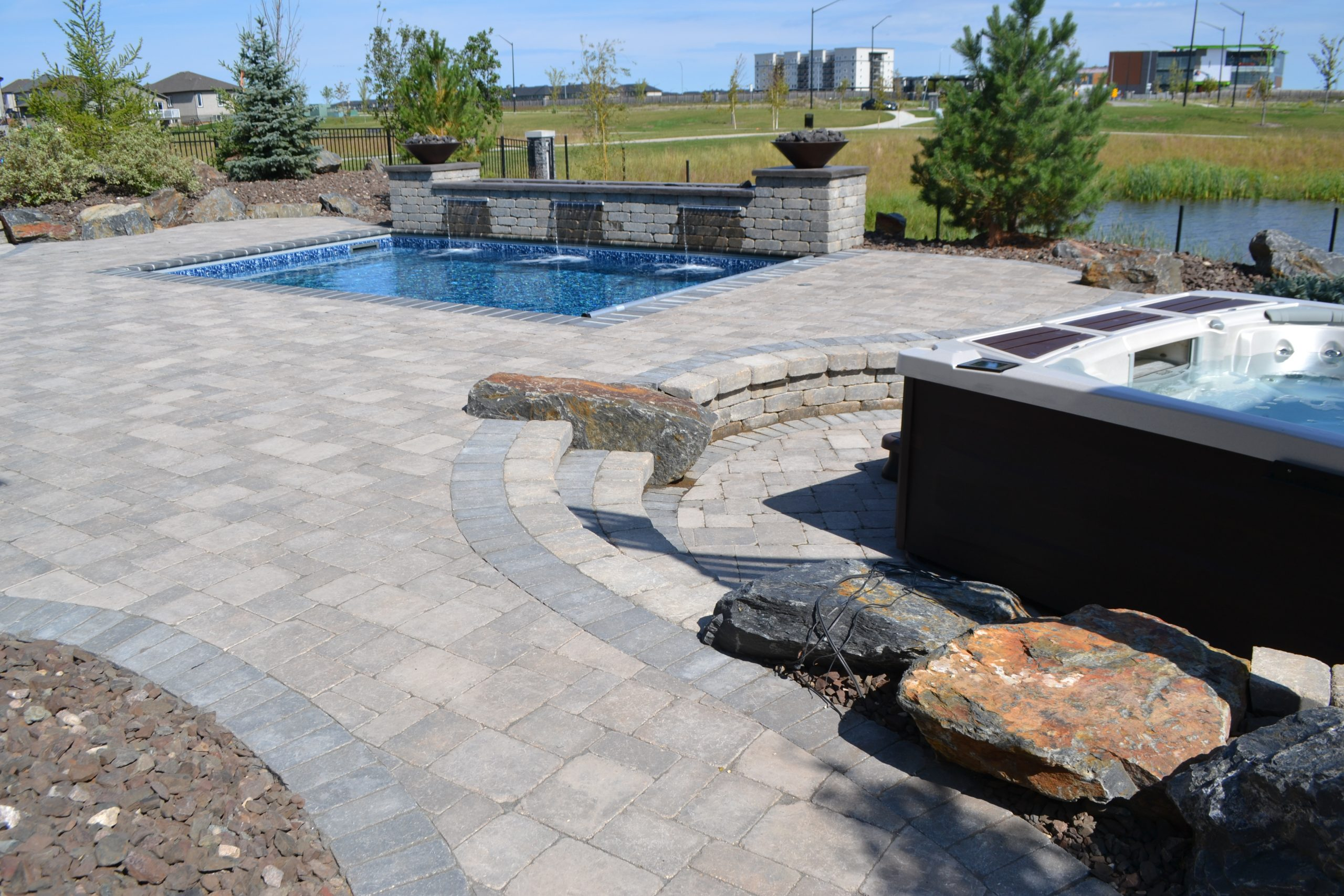 custom stonework by pool and hot tub