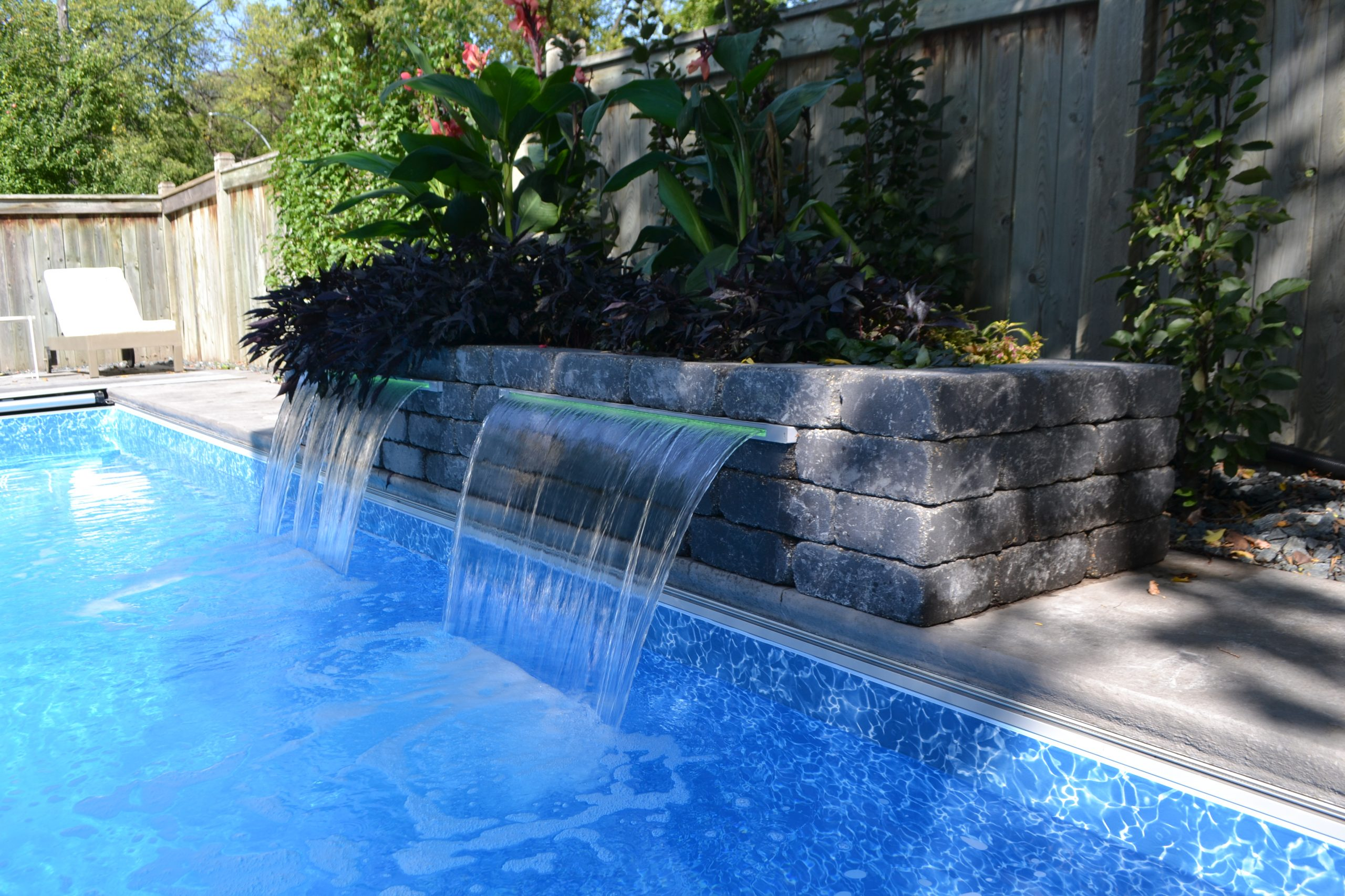 sheer descent water feature to pool