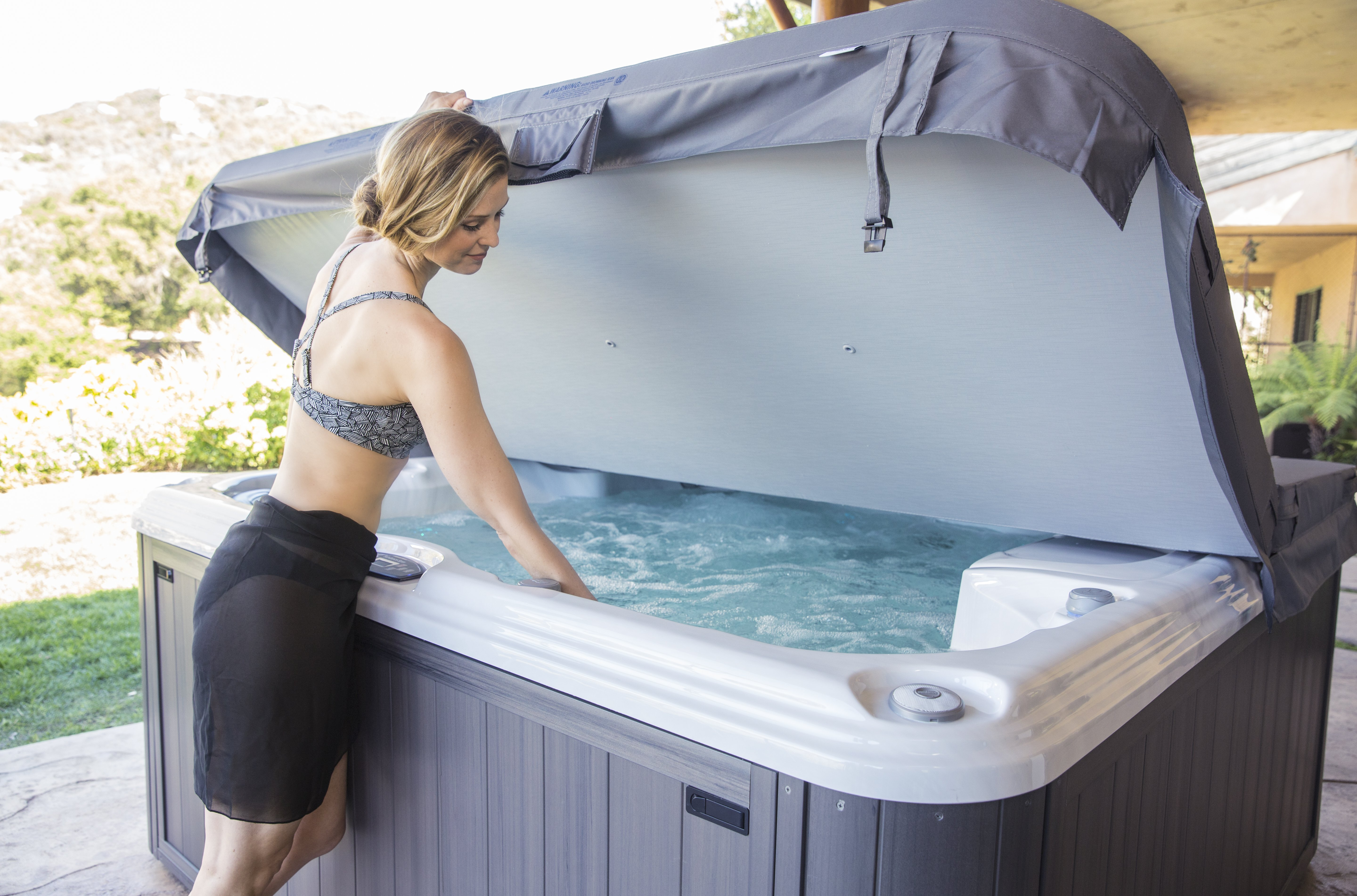 q how much do hot tubs cost a the typical range for hot. Black Bedroom Furniture Sets. Home Design Ideas